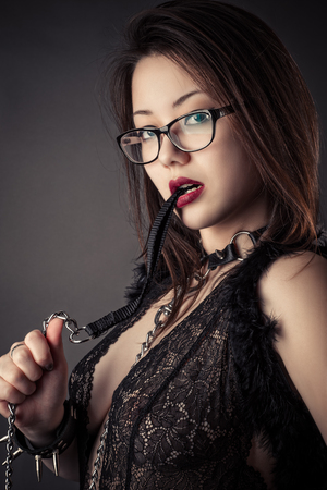sadomasochism: beautiful sexy Korean girl with leash in mouth