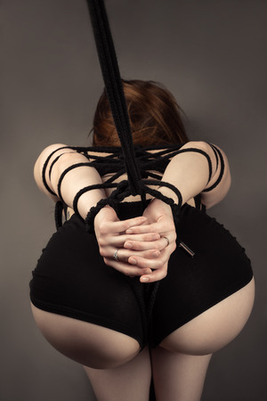Sexy ass female slave with tied hands closeup Stock Photo