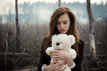 Teen girl holding tey bear 4