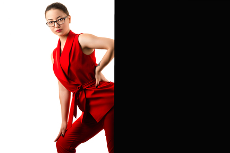 fashionable business woman in red suit on black and white Stock Photo