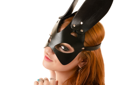 attractive young woman in black bunny mask