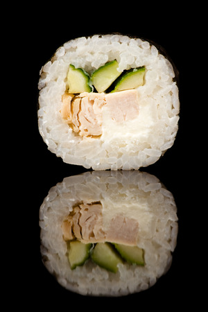 sushi roll in reflection closeup isolated on black background Stockfoto