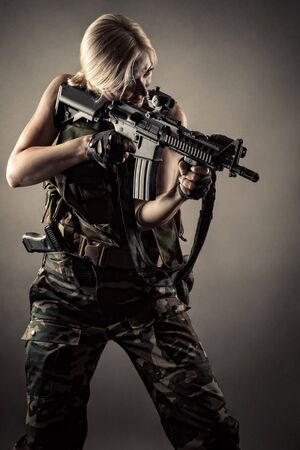 woman soldier with guns in hands