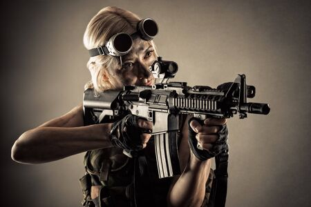 brutal blond woman with gun in hands
