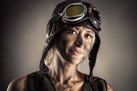 beautiful portrait woman in helmet with dirty face