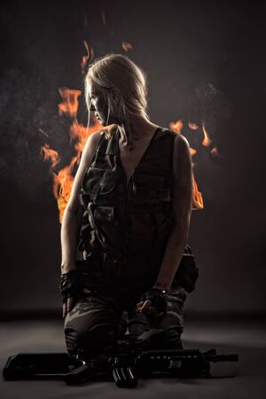 burning military woman Banco de Imagens
