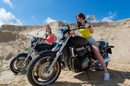 brutal girls on motorcycles on nature