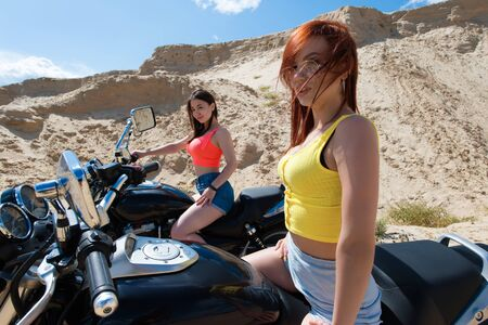 two young attractive women on motorcycle
