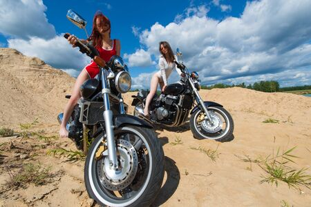 two attractive young girls on motorbikes Zdjęcie Seryjne