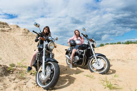 two beautiful girls on motorcycles