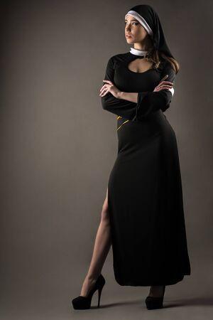 beautiful young caucasian woman nun standing in full length