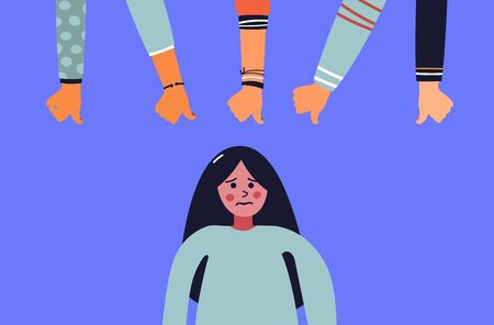 Dislike it concept. Unhappy young woman surrounded by hands with thumbs down at her. Concept of victim blaming, public disapproval, humiliation, abjection, guilt.