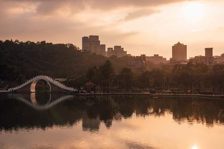 Sunset over Moon bridge in Dahu Park, Taipei, Taiwan