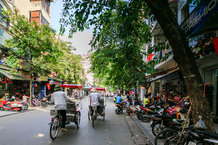 pedicabs in old town Hanoi Sajtókép