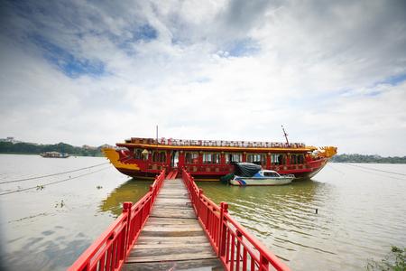wooden bridge: Wooden bridge for dragon boat on river H??ng-Hue VietNam Stock Photo