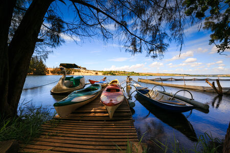 five objects: Dugout canoes on the lake
