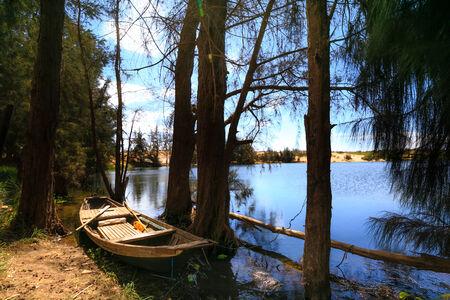 dugout: Dugout canoe on the lake Stock Photo