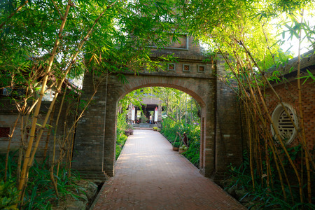 county side: Rural village gate Vietnam