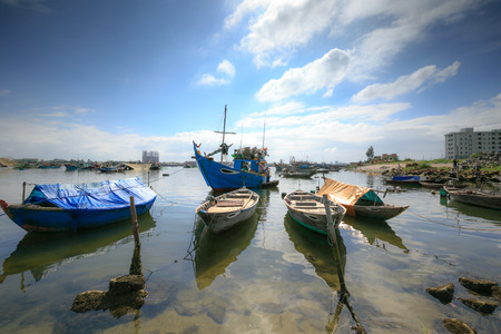 vietnamese ethnicity: Fishing boats and coracles in the bay Stock Photo