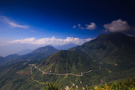 unsurfaced road: Winding mountain road in Ha Giang province. Vietnam