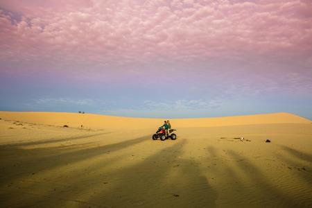 quad: Racing quad jumping sand dunes