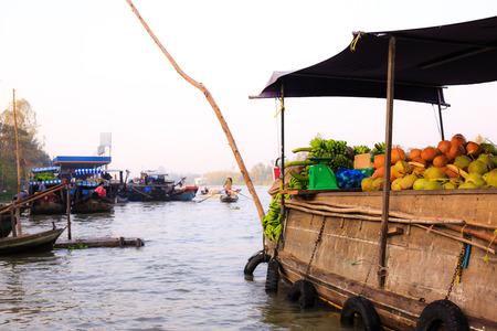 vietnamese ethnicity: Selling fruit on floating market