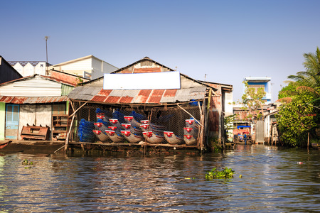 south asian ethnicity: Shop small boats on the river