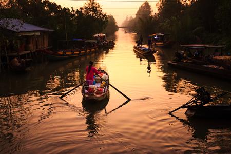 adult vietnam: Vietnamese woman selling fruit on floating market