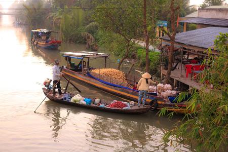 Vietnamese woman selling fruit on floating market