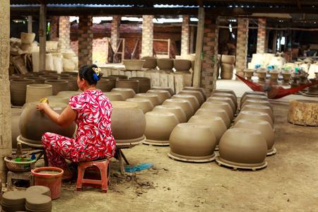 vietnamese ethnicity: woman working in ceramics workshop