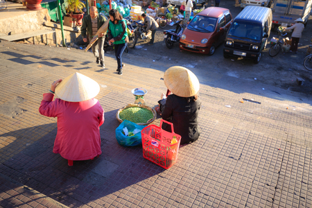 Vietnam Women selling vegetables at the market