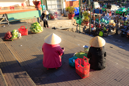Vietnam Women selling vegetables at the market photo