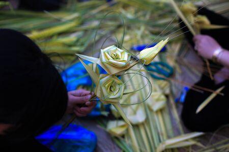 kids weaving: Toys handmade from coconut leaves
