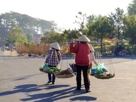 sidewalk sale: three Asian women hawkers Stock Photo