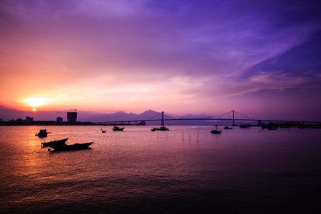 Boat on Han River in Danang in Vietnam sunset Foto de archivo