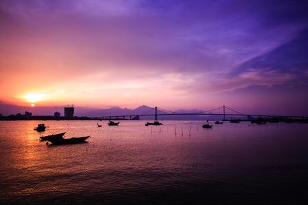 Boat on Han River in Danang in Vietnam sunset Stock fotó