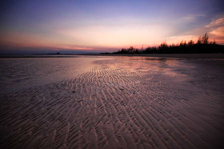 beach sunset: sand on the beach at sunset image Stock Photo