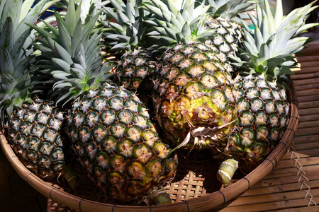 fairs: The pineapple in a basket at a fruit 39s Fairs Stock Photo