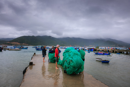 lining up: Vietnam Phan Rang city January 2 2015: Unknown nhng Fishermen in the fishing village of Phan Rang are lining up nets Preparing for the Upcoming stroller voyage