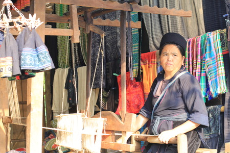 Vietnam Sapa city October 10 2014: Minority ethnic Hmong woman Brocade Looms parties. This fabric is woven by hand very beautiful colors is found to be many Tourists prefer