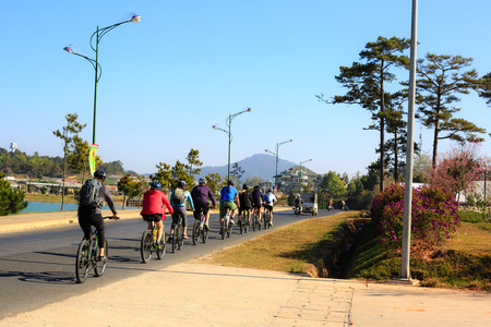 gran prix: Vietnam Da Lat city February 11 2015: Tourists on street cycling on a sunny morning Dalat. Dalat very Suitable for sports hot the temperature of the day here is always 20 degrees C