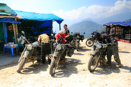 qui: Sapa Vietnam October 9 2014: The unidentified men was resting on top of the pass named HO O QUI on the way to the town of Sapa Vietnam discovery Editorial