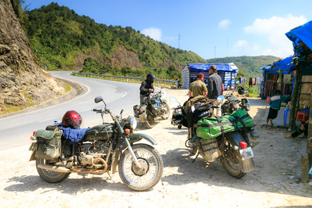 qui: Sapa Vietnam October 9 2014: The unidentified men was resting on top of the pass named HO O QUI on the way to discovery the town of Sapa Vietnam Editorial