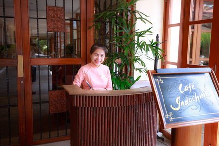 front desk: beautiful young asian indoor hotel front desk receptionist