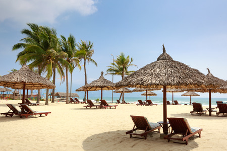 scene season: Chairs and umbrella on a beautiful tropical beach at Da Nang Vietnam