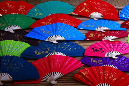 paper fan: Vietnam Ho Chi Minh city May 28 2015: the colorful paper fans in a shop at the fair in downtown Ho Chi Minh City is a typical paper fan cultural features of Vietnam as well as the Asian ngi region Editorial