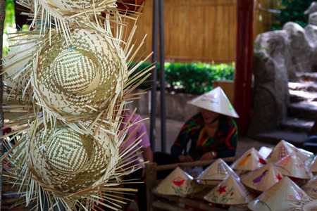 conical hat: Vietnam Ho Chi Minh city May 28 2015: the conical hat was painted colorful leaves in a shop at the fair in downtown Ho Chi Minh conical hat is a culture bit by ngi Vietnam Editorial