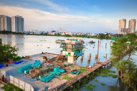 construction material: Hochiminh City Vietnam June 3 2015: the construction Workers steel and beton pier for metro lines crossing the Saigon River