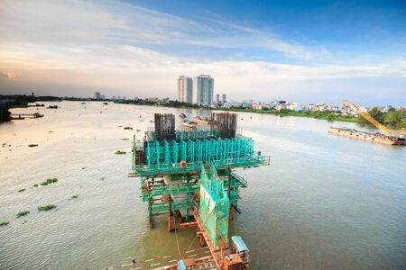 Hochiminh City Vietnam June 3 2015: the construction Workers steel and beton pier for metro lines crossing the Saigon River