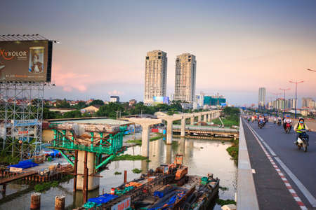 beton: Ho Chi Minh City Vietnam June 3 2014: beton pier giant newly built subway lines cross the street for Saigon River Editorial